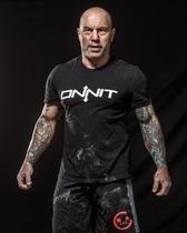 Joe Rogan - Wolf or Tribal Tattoo Sleeve on the Right Arm