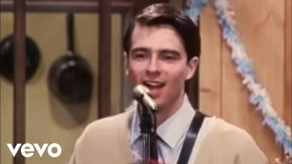 Watch Weezer - Buddy Holly  now