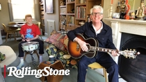 Watch Nick Lowe Performs '(What's So Funny 'Bout) Peace, Love, and Understanding' From Home | In My Room now